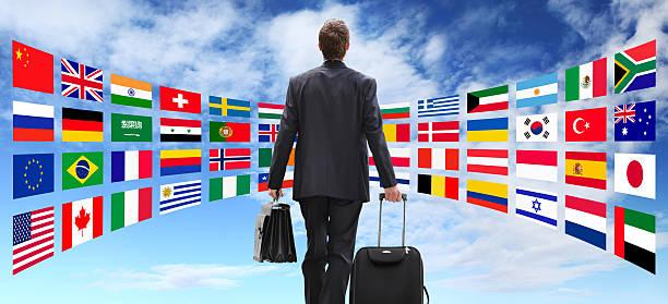 International business man viaje con ruedas, el concepto de negocio global - foto de stock