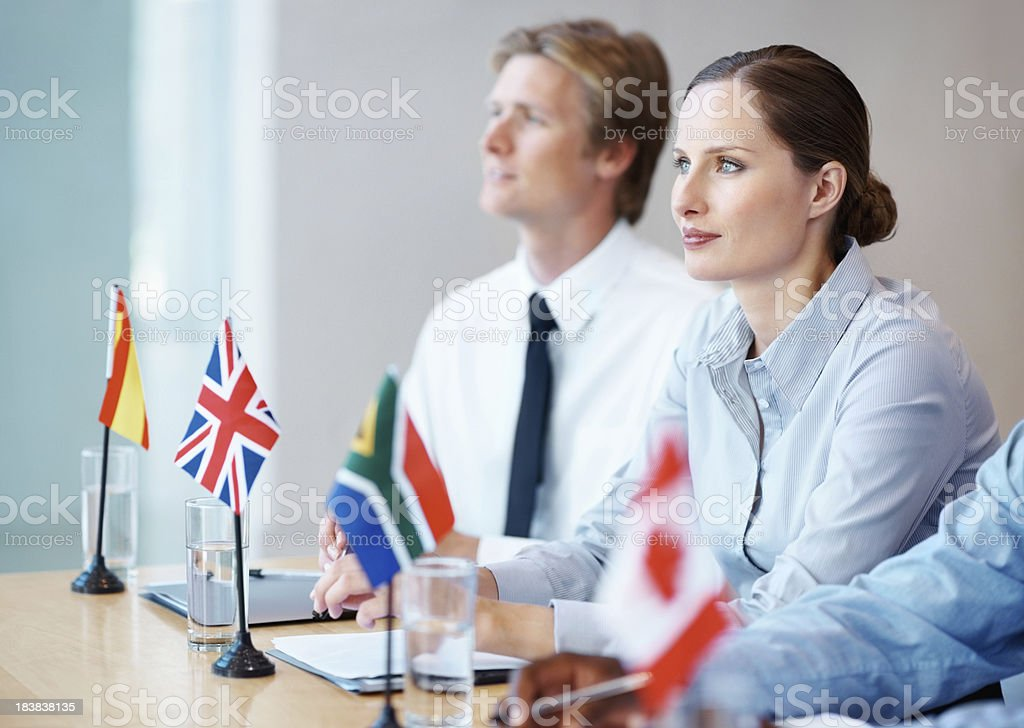 International business people in a meeting stock photo