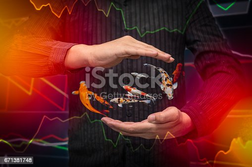 istock International business Stock finacial concept with businessman hand, His business growth and progress with Stock market digital graph chart on LED display 671381748