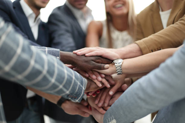 international business team shows its solidarity stock photo