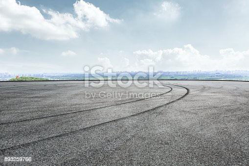 istock International circuit asphalt road and blue sky landscape 893259766