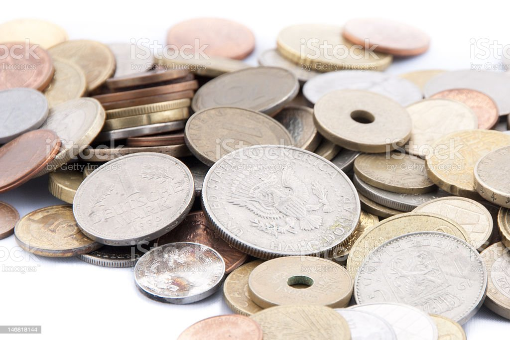 international coins on white table cloth royalty-free stock photo