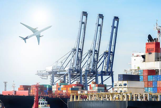 International Container Cargo ship and Cargo plane - foto de acervo