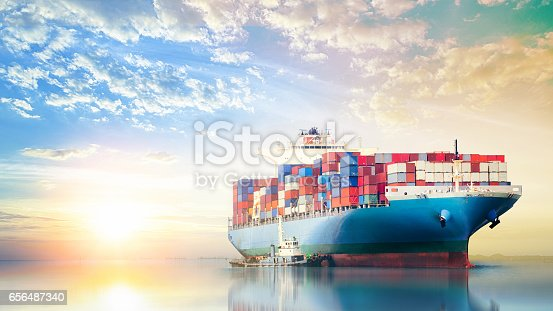 istock International Container Cargo ship in the ocean at sunset sky, Freight Transportation, Nautical Vessel 656487340