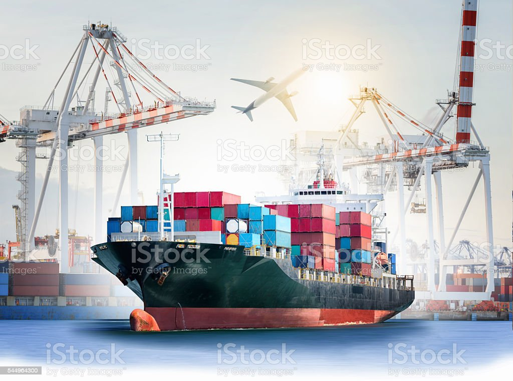 International Container Cargo ship with ports crane bridge in harbor - Photo