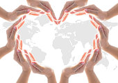 istock International cooperative, charity aid, friendship and world protection concept with heart collaborative hands 973565362
