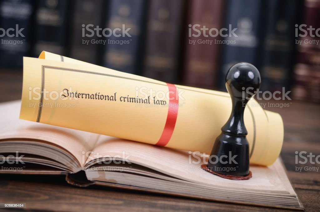 International criminal law and notary seal on a wooden background, legality concept. stock photo