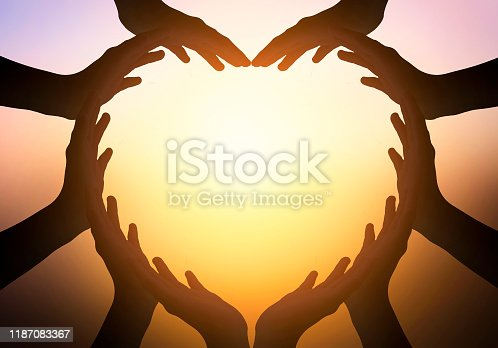 International Day of Friendship concept: Family at sunrise background