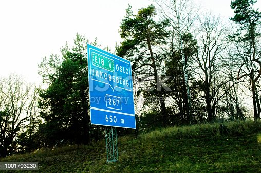 144334852 istock photo International E18 V & Route 267 Motorway To Oslo Norway & Jakobsberg Sign Board 1001703230