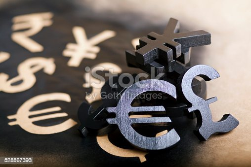 International black currency units on dappled background