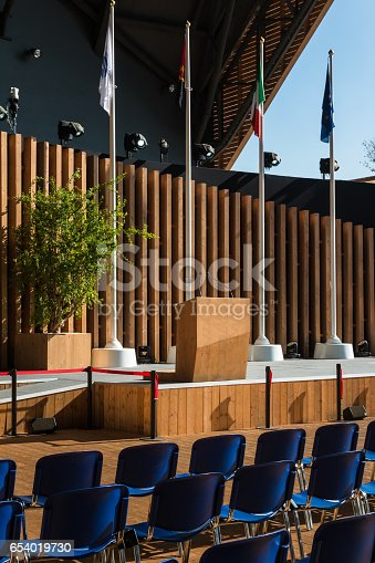 821463698 istock photo International Empty Conference Room with Flag Ready for Audience 654019730