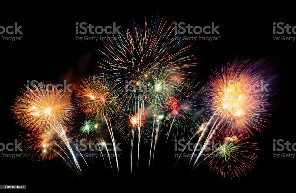 International fireworks festival display at night. Variety of colorful fireworks in holidays celebration isolated on black. Happy New Year Background. International fireworks festival display at night. Variety of colorful fireworks in holidays celebration isolated on black. Happy New Year Background. Abstract Stock Photo