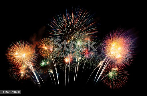 istock International fireworks festival display at night. Variety of colorful fireworks in holidays celebration isolated on black. Happy New Year Background. 1152679400