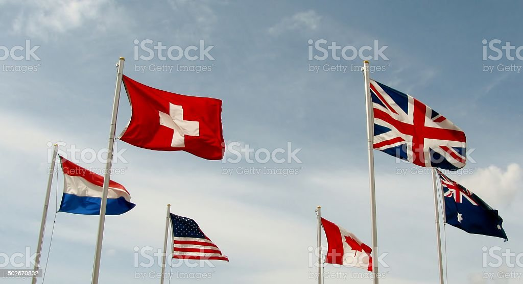 International flags fly side by side stock photo