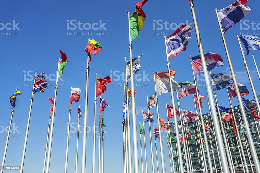International flags in front of a business building royalty-free stock photo