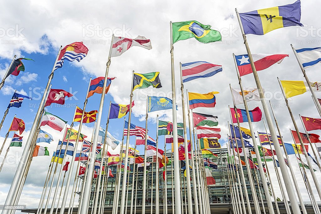 International flags in front of an business building stock photo