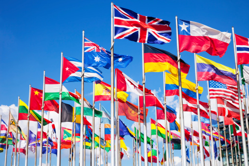 international flags and sun in the blue sky