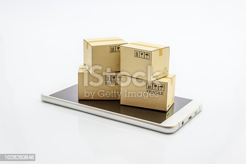 868776578 istock photo International freight service for online shopping or ecommmerce concept : Paper boxes with logos on a white smart mobile phone device. Consumers always shop goods or things online using the internet. 1028280846
