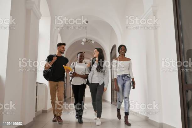 International group of four students with backpacks picture id1159419950?b=1&k=6&m=1159419950&s=612x612&h=om5dtwjcng0fm9wb x2q3zxlvs4uirqbjhzsbmsjo4c=