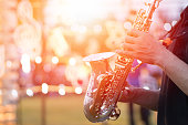 International jazz day and World Jazz festival. Saxophone, music instrument played by saxophonist player musician in fest.