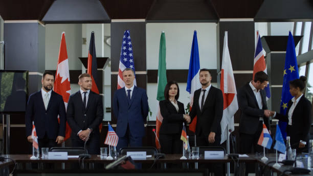 International leaders posing for photo Members of Group of Seven taking photo against countries flags on international meeting in boardroom diplomacy stock pictures, royalty-free photos & images