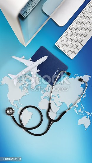 istock international medical travel insurance concept,stethoscope, passport, computer and airplane on sky background with global map 1159659219