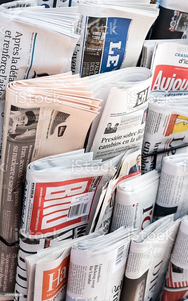 International Newspapers on a Newsstand stock photo