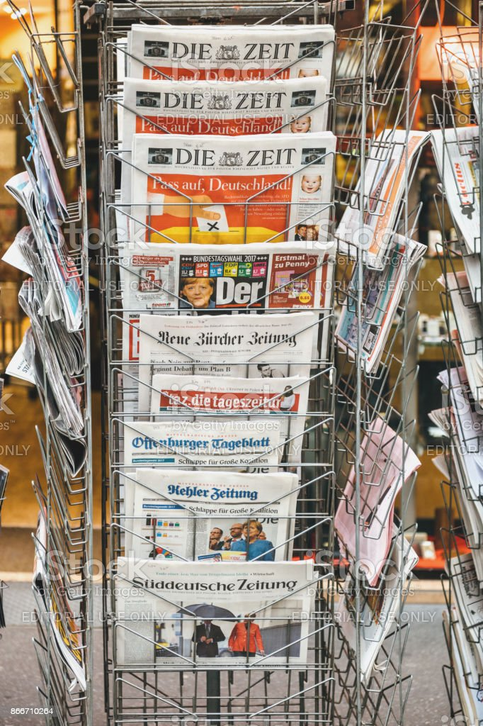 International newspapers reporting about elections in Germany stock photo