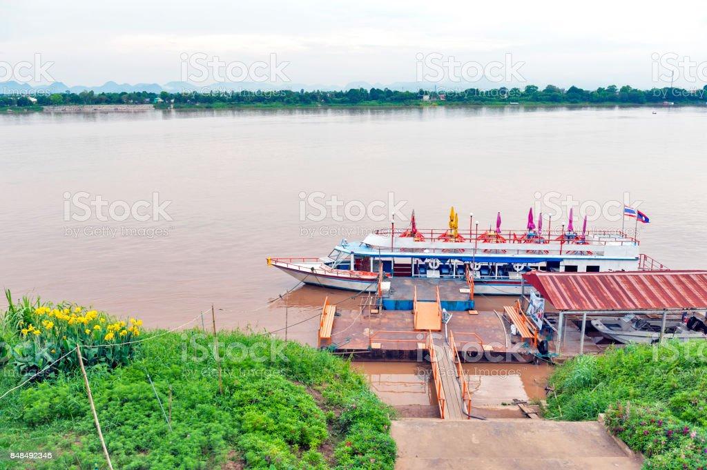 International passenger boat operated across Mekong River between city of Nakhon Phanom in Thailand and Thakhek, Khammouane Province in Laos stock photo