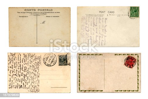 Four old postcards from different countries, two with messages.