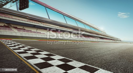 Wide angle view empty asphalt international race track with start and finish line , motion blur effect apply .