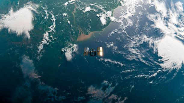 International Space Station (ISS) Orbit in Space over Amazon River - SpaceX & NASA Research - 3D Rendering ISS orbiting over the end of the Amazon River. Top down view.  Planet map and ISS model from NASA: https://eoimages.gsfc.nasa.gov/images/imagerecords/74000/74192/world.200411.3x21600x21600.D2.png https://solarsystem.nasa.gov/resources/2378/international-space-station-3d-model/  Tools and software used: Blender 2.8 satellite view stock pictures, royalty-free photos & images