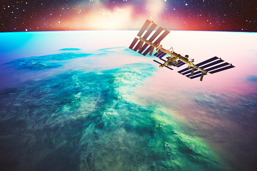 International Space Station Orbiting Earth Like Planet Stock Photo - Download Image Now