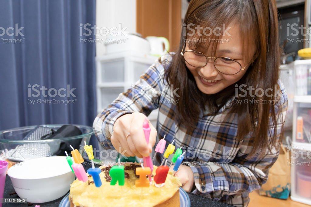 International student decorating birthday cake