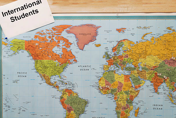 international students around the world on map concept stock photo
