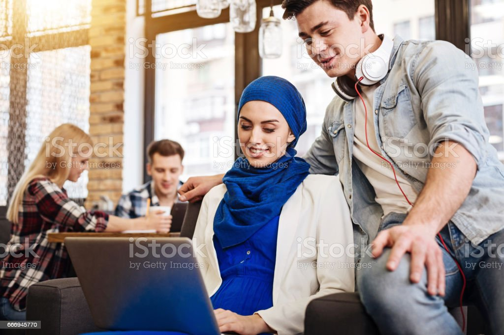 International students using laptop stock photo