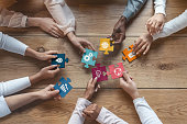 istock International team of coworkers putting colorful puzzles together 1201193769