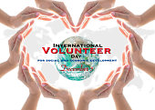 istock International volunteer day for social and economic development concept: Elements of this image furnished by NASA 1185540832