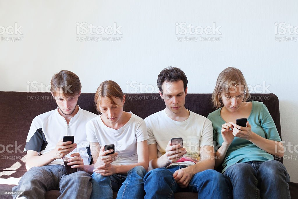 internet addiction concept, group of people with their smartphones stock photo