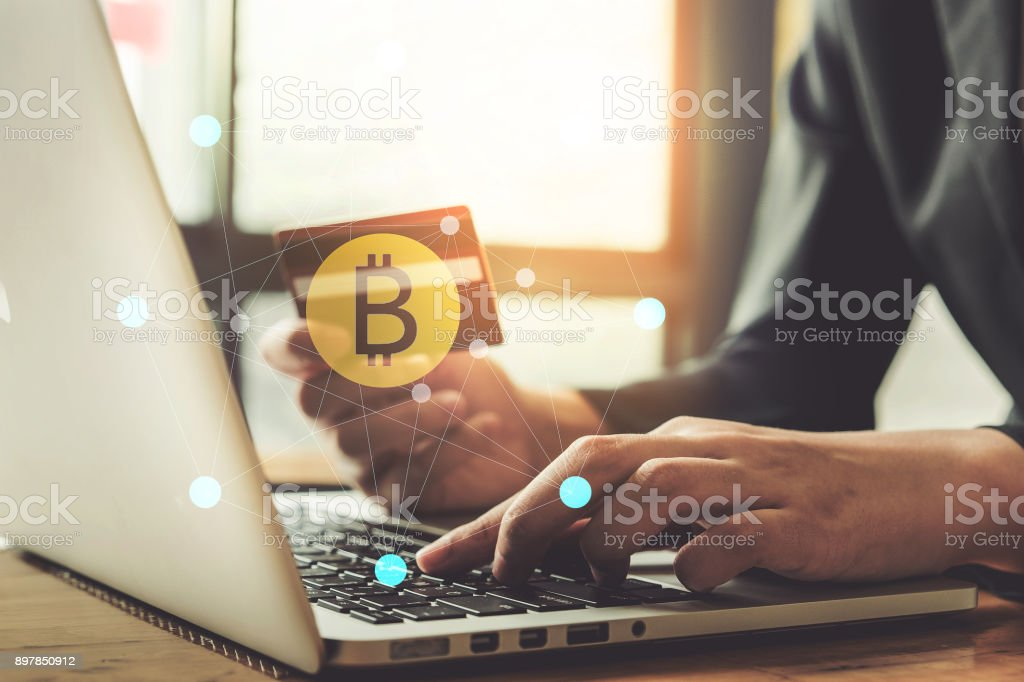 internet banking network and cryptocurrency concept. Man hand using credit card for trade cryptocurrency. - fotografia de stock