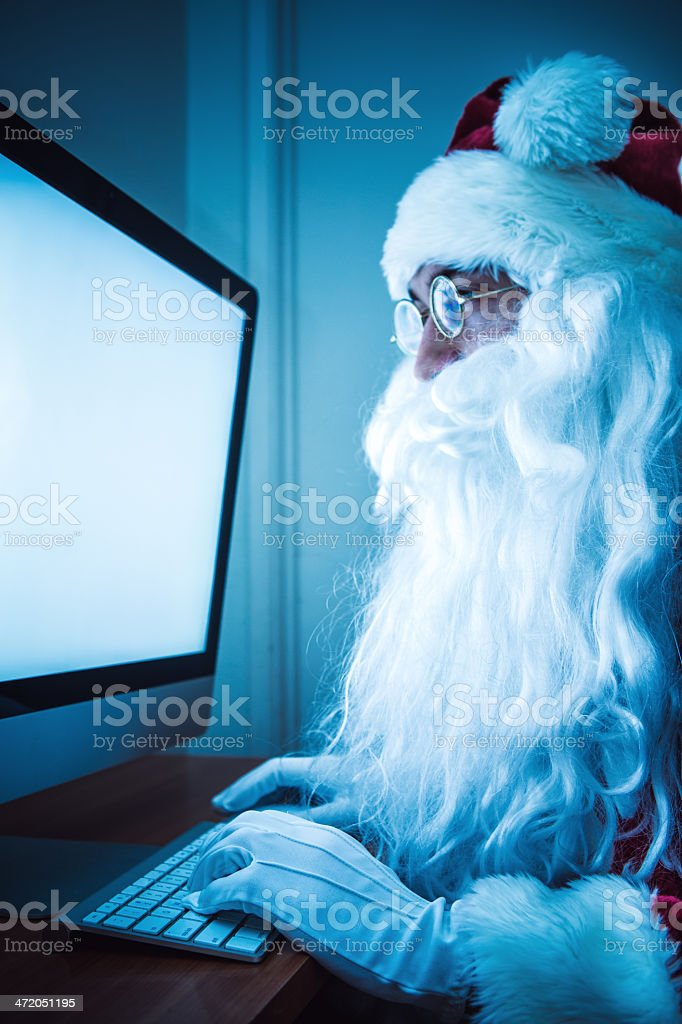 Internet Browsing Santa Claus stock photo