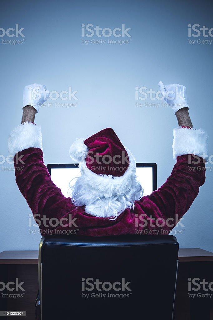 Internet Browsing Santa Success stock photo
