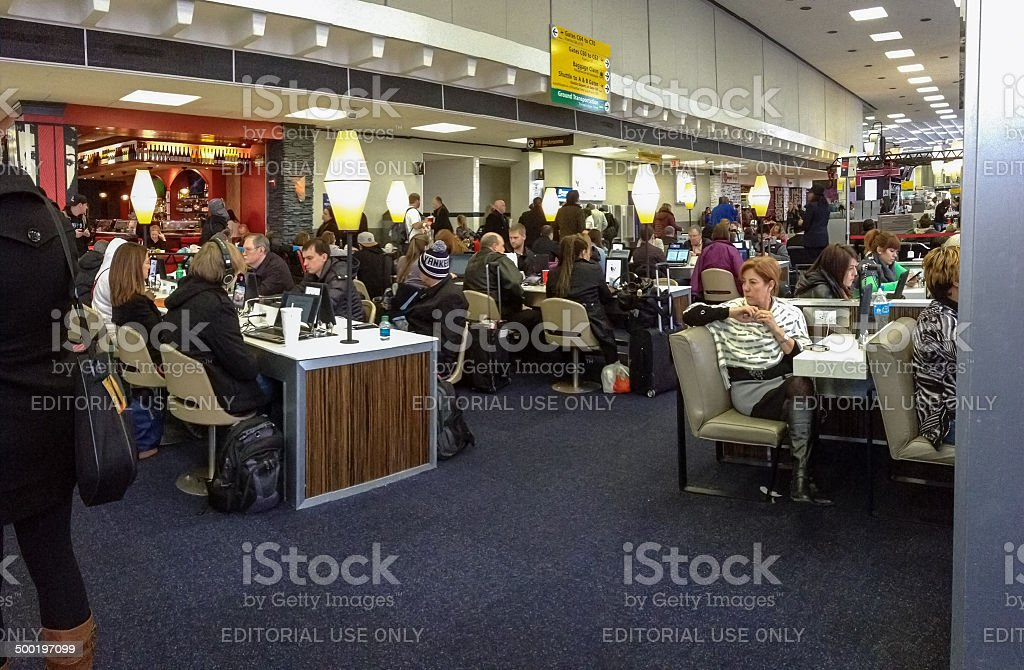 Internet cafe equipped with iPads at JFK airport terminal royalty-free stock photo
