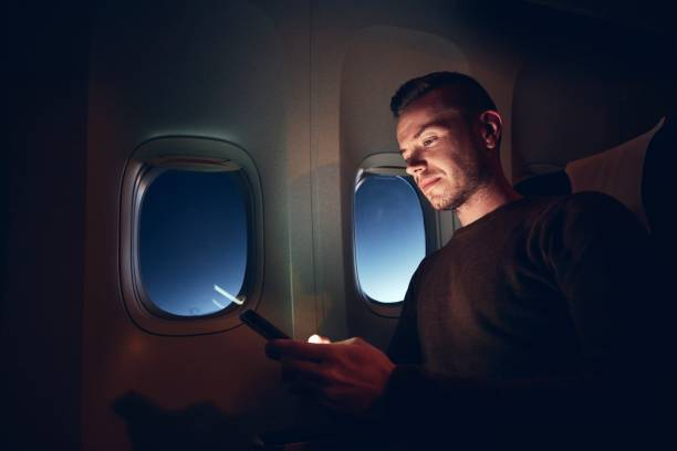 Internet connection during night flight stock photo