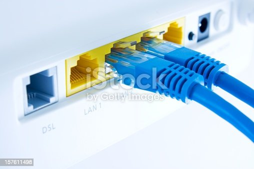close up of a lan switch with pluged in cables,