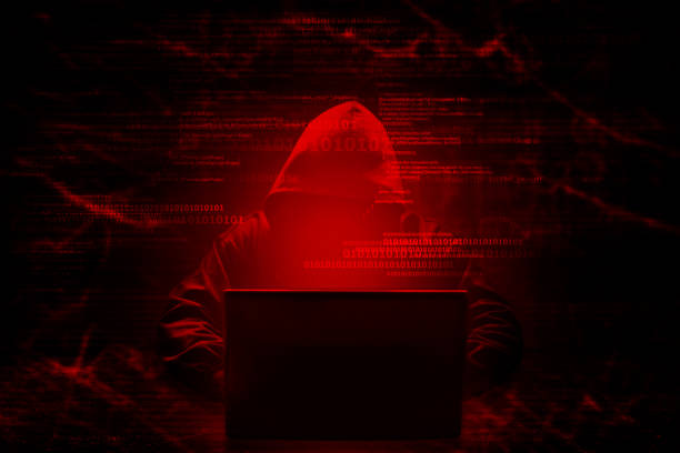 Internet crime concept. Hacker working on a code on dark digital background with digital interface around. Internet crime concept. Hacker working on a code on dark digital background with digital interface around. computer crime stock pictures, royalty-free photos & images
