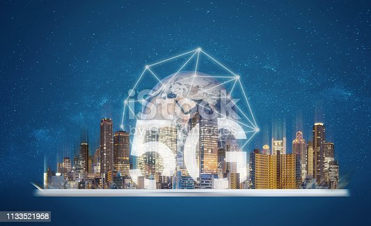 istock 5G internet networking technology, Digital tablet with building hologram and 5G technology. Element of this image are furnished by NASA 1133521958