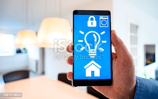 istock Internet of things app turns on lights in smart home 1097519520