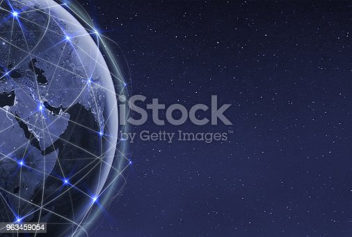 878855462istockphoto Internet of things .Global communication technology and telecommunication financial network around planet Earth. Blockchain and cryptocurrency concept with copyspace. IOT. Elements of this photo furnished by NASA. 963459054
