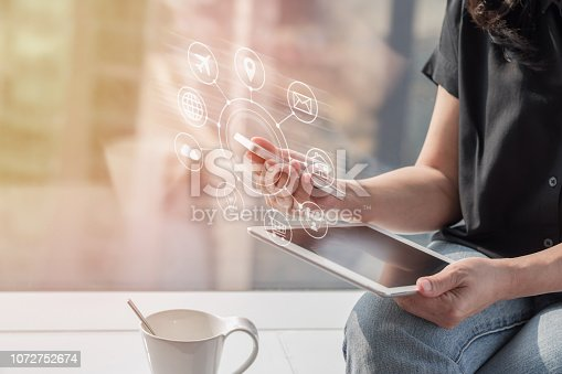 istock Internet of things - IOT via communication network service on mobile apps and smartphone and tablet technology for people in digital 4.0 lifestyle 1072752674